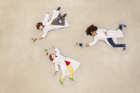 Children Wearing Laboratory Coats Doing Experiments