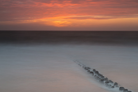Germany, Schleswig-Holstein, Sylt, North Sea, Breakwaters, Afterglow