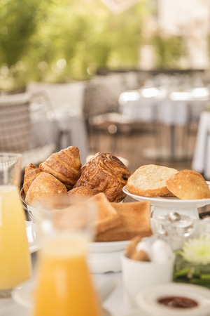 Germany, Breakfast, Bread Roll, Croissants And Juice On Terrace LANG_EVOIMAGES