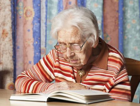 Portrait Of Senior Woman Reading A Book LANG_EVOIMAGES