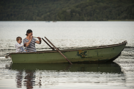 Germany, Rhineland-Palatinate, Laacher See, Father And Son With Telescope In Boat
