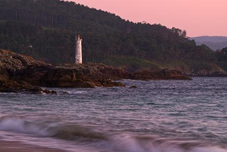 Spain, Galicia, Lighthouse At Beach Of Leis De Nemancos