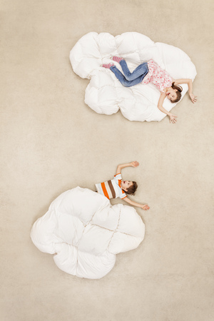 Children Playing In Clouds