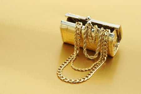 Open Gold Purse With Gold Jewelry