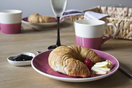 Croissant With Butter On Plate, Jam And Cafe Au Lait