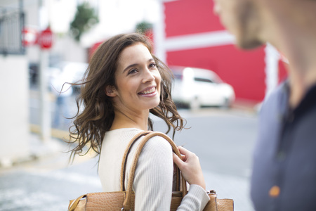 Portrait Of Smiling Woman With Meeting A Friend On The Street LANG_EVOIMAGES