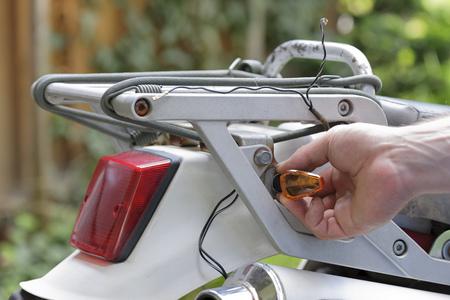 Young Man Repairing Enduro Motorcycle