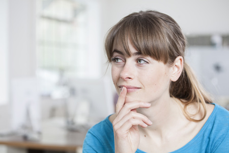 Portrait Of Thoughtful Young Woman In An Creative Office