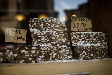 Italy, Tuscany, Pisa, Shop Window With Traditional Tuscan Fruit Cake Panforte