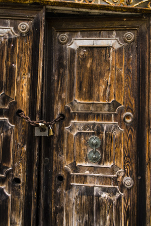 Italy, Comacchio, Old Door With Chain And Padlock