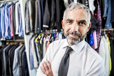 Portrait Of Businessman At His Walk-In Closet