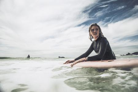 France, Bretagne, Camaret Sur Mer, Teenage Girl Surfing At Atlantic Coast LANG_EVOIMAGES