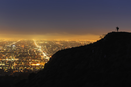 Usa, California, Los Angeles, Cityscape And Photographer On A Mountain LANG_EVOIMAGES