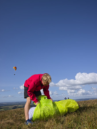 Man Packing His Paraglider