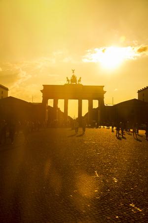 Germany, Berlin, Berlin-Mitte, Brandenburg Gate, Pariser Platz And Tourists Against The Sun