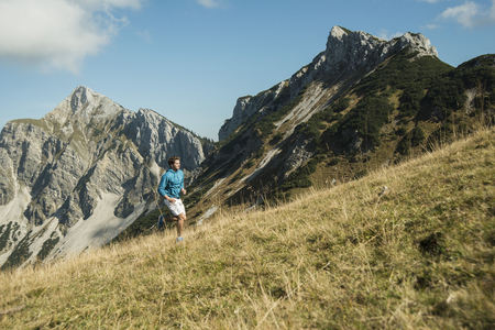 Austria, Tyrol, Tannheim Valley, Young Man Jogging In Mountains