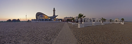 Germany, Mecklenburg-Western Pomerania, Warnemuende, Old Lighthouse, Teepott And Beach Bar In The Morning Light, Panorama LANG_EVOIMAGES