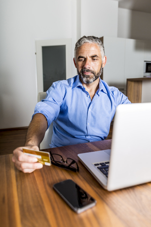 Portrait Of Businessman Using His Creditcard For Online Banking