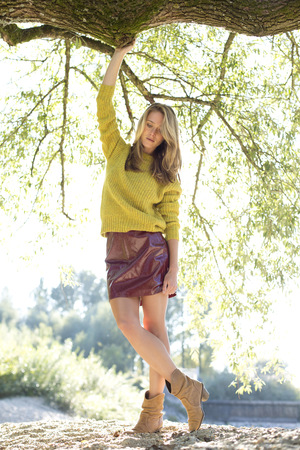 Young Woman Wearing Knit Pullover And Mini Skirt