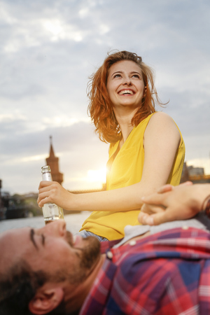 Germany, Berlin, Young Couple Enjoying Sunset At Spree River LANG_EVOIMAGES