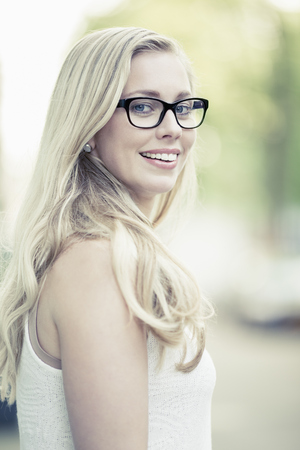 Portrait Of Smiling Young Woman Wearing Glasses