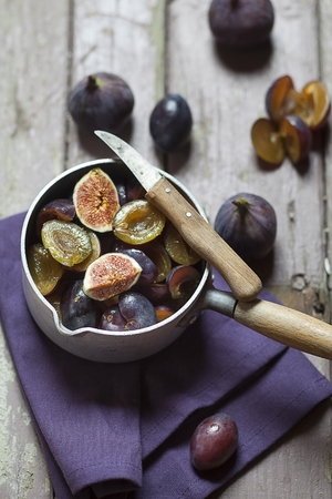 Casserolle Of Sliced Figs And Plums For Making Jam