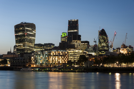 United Kingdom, England, London, River Thames, High-Rise Buildings, Swiss Re Tower, Tower 42, 20 Fenchurch Street In The Evening Light