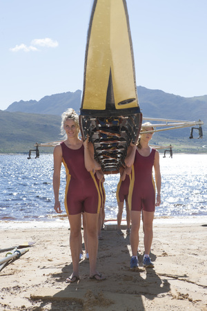 Female Rowers Lifting Up Boat LANG_EVOIMAGES