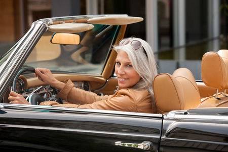 Portrait Of Mature Woman Sitting In A Convertible Car