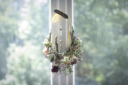 Self-Made Floral Wreath Hanging At Window Catch