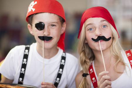 Children Dressed Up As Pirates Having Fun On A Party