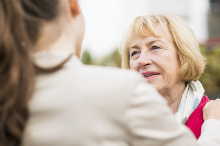 Portrait Of Blond Senior Woman Communicating With Her Granddaughter LANG_EVOIMAGES