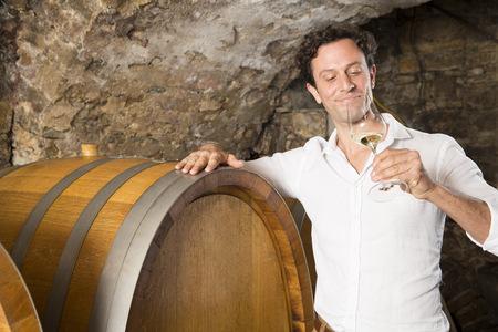 Man In Wine Cellar Tasting Wine LANG_EVOIMAGES