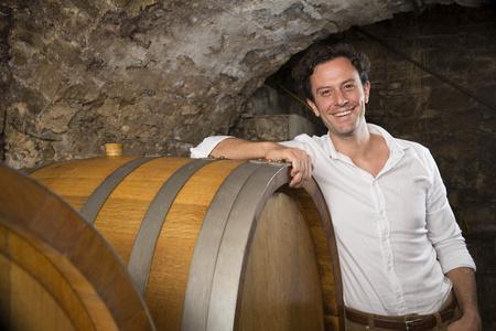 Portrait Of Smiling Man In Wine Cellar LANG_EVOIMAGES