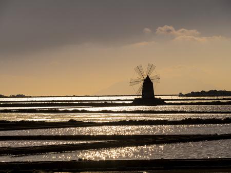 Italy, Sicily, Province Of Trapani, Marsala, Laguna Dello Stagnone, Saline Ettore Infersa, Wind Mill In The Evening