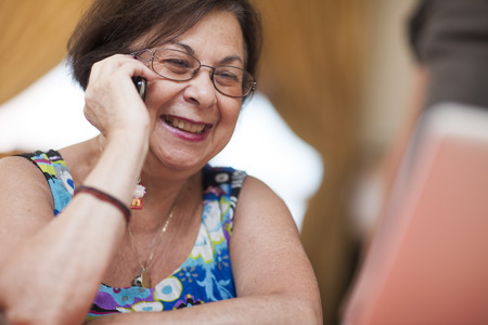 Smiling Senior Woman On Cell Phone LANG_EVOIMAGES