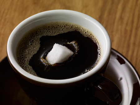 Sugar Cube In Cup Of Coffee