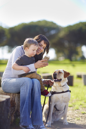 Mother And Little Son With Dog LANG_EVOIMAGES