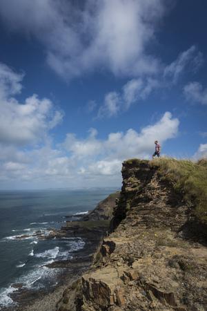 United Kingdom, England, Cornwall, Hiker at High Cliff