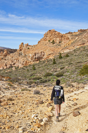 Spain, Canary Islands, Tenerife, Roques de Garcia, Teide National Park, Female hiker in the Caldera de las Canadas LANG_EVOIMAGES