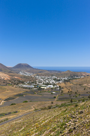 Spain, Canary Islands, Lanzarote, Maguez, Village Haria and Volcano Monte Corona in the background LANG_EVOIMAGES