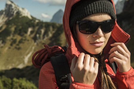Austria, Tyrol, Tannheimer Tal, female hiker wearing sunglasses LANG_EVOIMAGES