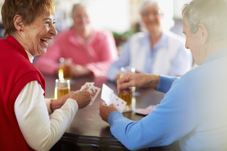 Senior friends playing cards