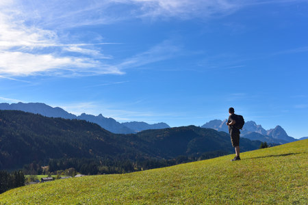 Germany, Bavaria, Allgaeu, hiker near Geroldsee