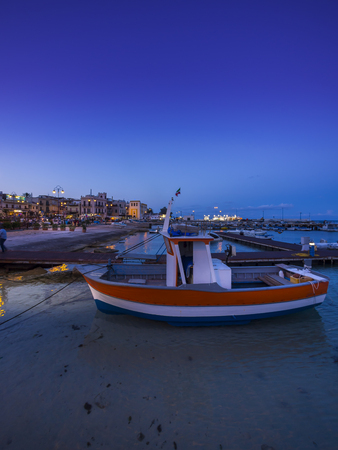 Italy, Sicily, Province of Palermo, Mondello, Harbour, Fishing boat in the evening LANG_EVOIMAGES