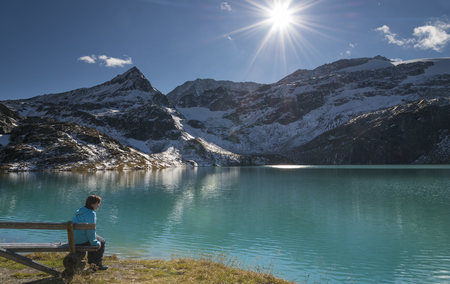 Austria, Salzburg State, Pinzgau, woman at Weisssee mountain lake LANG_EVOIMAGES