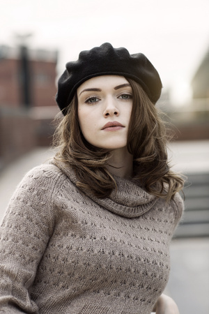 Portrait of young woman wearing beret and knitted dress LANG_EVOIMAGES