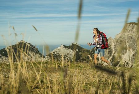 Austria, Tyrol, Tannheimer Tal, young woman hiking