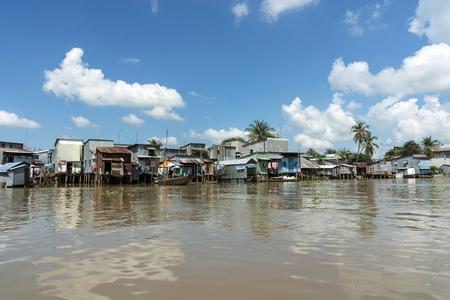 Vietnam, An Giang, Long Xuyen, view to pile dwellings at riverside of Mekong