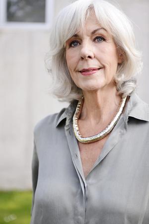 Portrait of white haired senior woman